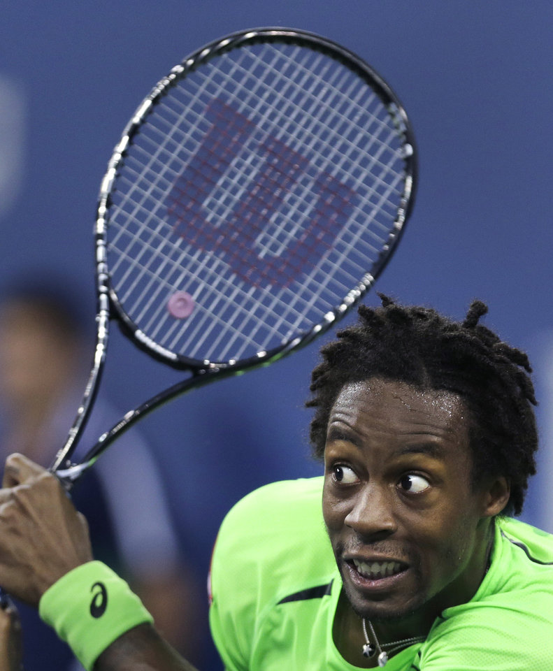 Photo - Gael Monfils, of France, watches his return to Roger Federer, of Switzerland, during the quarterfinals of the U.S. Open tennis tournament, Thursday, Sept. 4, 2014, in New York. (AP Photo/Charles Krupa)