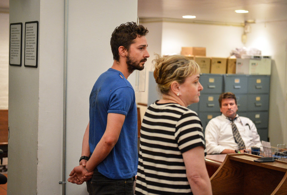 Photo - Shia LaBeouf, left, represented by a Legal Aid attorney, is arraigned in Midtown Community Court, in New York, Friday, June 27, 2014. LaBeouf was released from police custody Friday after he was escorted from a Broadway theater for yelling obscenities and continued to act irrationally while being arrested, authorities said. He's due back in court July 24.(AP Photo/Daily News, Anthony DelMundo, Pool)