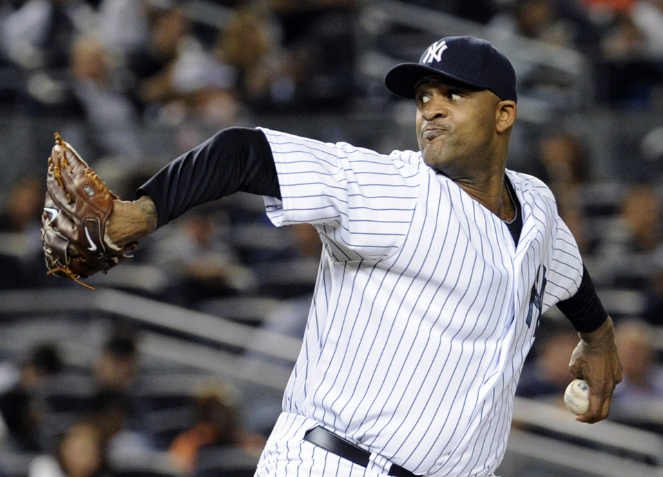 Photo - New York Yankees pitcher CC Sabathia delivers the ball during the second inning of an interleague baseball game against the San Francisco Giants, Friday, Sept. 20, 2013, at Yankee Stadium in New York. (AP Photo/Bill Kostroun)