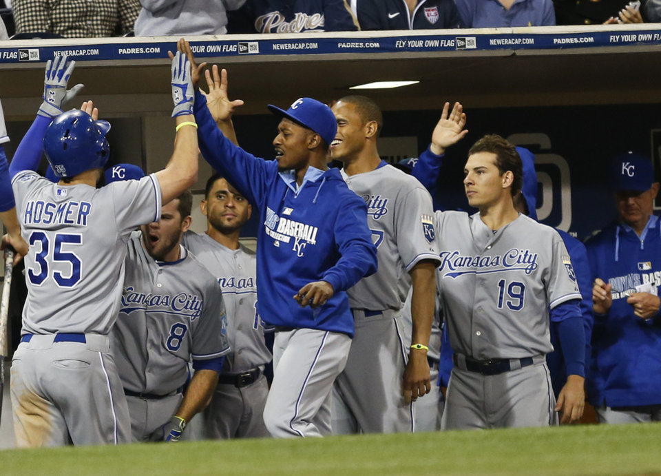 Photo - Kansas City Royals' Eric Hosmer is greeted by teammates after his solo homer against the San Diego Padres in the seventh inning of a baseball game Monday, May 5, 2014, in San Diego.  (AP Photo/Lenny Ignelzi)