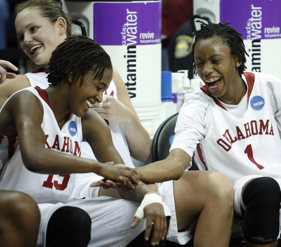 Photo - Danielle Robinson (13) and Nyeshia Stevenson (1) celebrate as the University of Oklahoma (OU) defeats Georgia Tech 69-50 in round two of the 2009 NCAA Division I Women's Basketball Tournament at Carver-Hawkeye Arena at the University of Iowa in Iowa City, IA on Tuesday, March 24, 2009. 