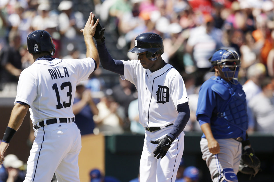 Photo - Detroit Tigers' Austin Jackson, right, is congratulated by teammate Alex Avila after his two-run home run during the second inning of a spring exhibition baseball game against the Toronto Blue Jays in Lakeland, Fla., Tuesday, March 18, 2014. (AP Photo/Carlos Osorio)