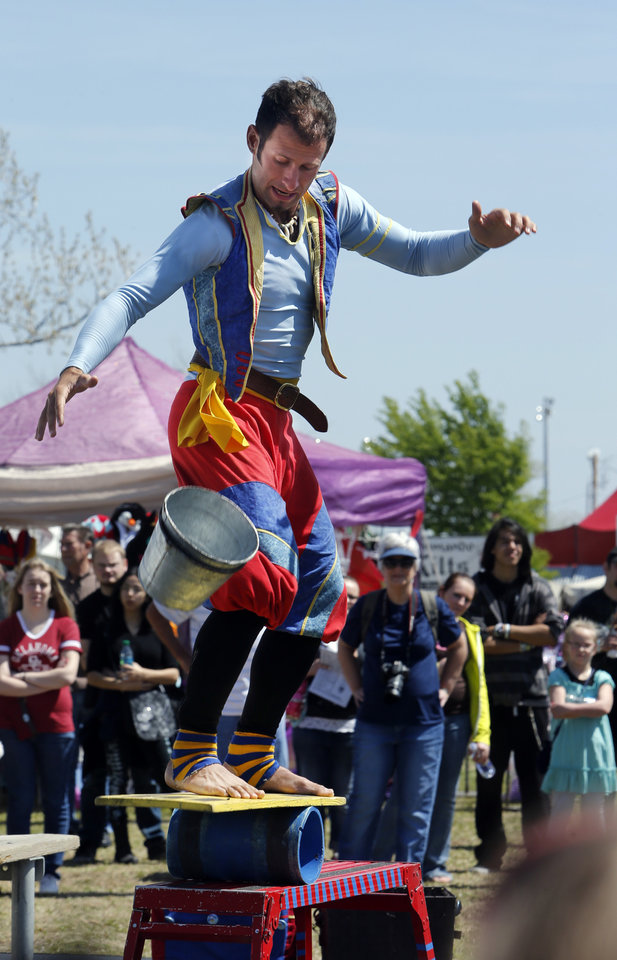 Cameron Tomele with Barely Balanced performs on a platform on a cylinder during the Medieval Fair at Reaves Park on Friday, April 5, 2013 in Norman, Okla.  Photo by Steve Sisney, The Oklahoman