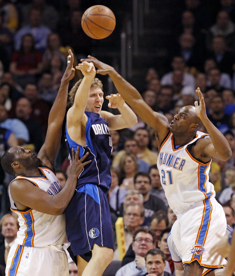 Dirk Nowitzki (41) of Dallas passes the ball away from the defense of Oklahoma City's Malik Rose (9), left, and Damien Wilkins (21) in the second half of the NBA basketball game between the Dallas Mavericks and the Oklahoma City Thunder at the Ford Center in Oklahoma City, March 2, 2009. The Thunder won 96-87. BY NATE BILLINGS, THE OKLAHOMAN