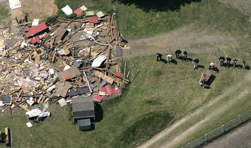 Photo -   FILE - In this May 24, 2006, file photo, workers, including Federal Bureau of Investigation evidence response team members, probe the ground near a demolished barn at a horse farm in Milford Township, Mich., where FBI agents investigating Jimmy Hoffa's 1975 disappearance were working for an eighth day. Hoffa's mysterious disappearance, assumed death and myriad searches for his body have been the stuff of urban legends for more than three decades. (AP Photo/Paul Sancya, File)