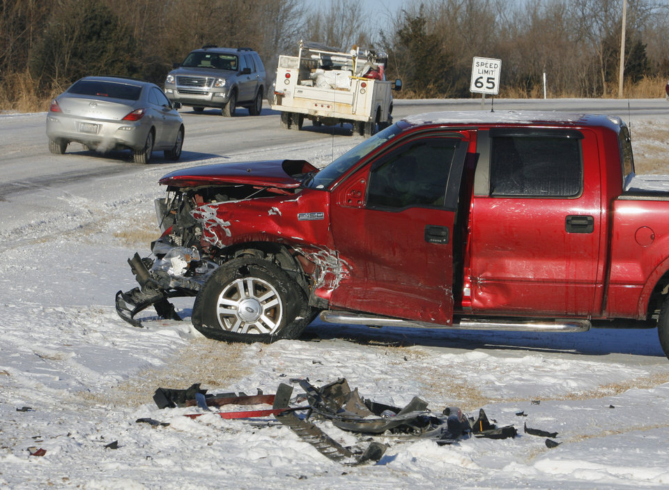 Photo - Only minor injuries were reported in a head-on collision on State Highway 74 two miles west of Purcell on Thursday, February 10, 2011, in Purcell, Okla.  A southbound Suburban slid on packed snow, crossed the center line and collided with a northbound pickup in the northbound lane. A third car following the Suburban slid into the Suburban after it came to rest on the side of the highway. Photo by Steve Sisney, The Oklahoman