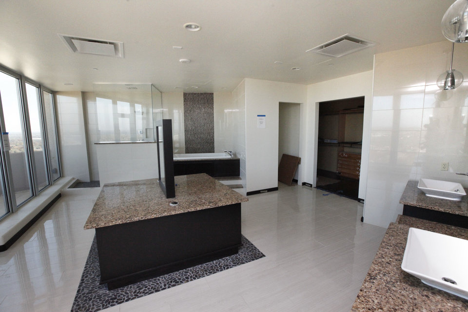 Photo - The expansive master bath and other spaces of the Founders Tower penthouse will be decorated by designers for the 2014 Symphony Show House.  PAUL HELLSTERN - The Oklahoman