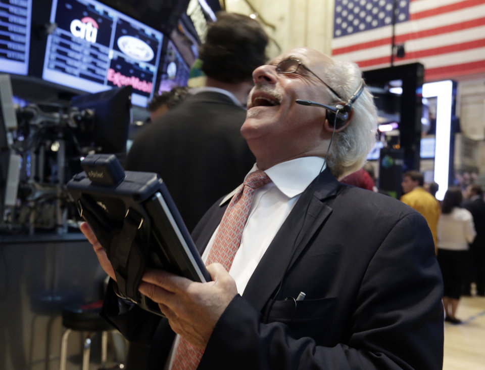 Photo - Trader Peter Tuchman reacts to another trader's comment as he works on the floor of the New York Stock Exchange Friday, Aug. 16, 2013. Stocks bounced back Friday from consecutive days of significant declines, with more evidence of a rebounding U.S. housing market.(AP Photo/Richard Drew)