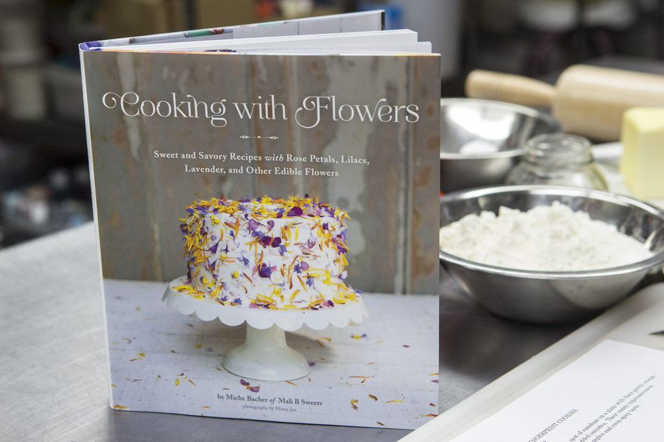 "Greenport chocolatier Miche Bacher just wrote a book titled, ""Cooking With Flowers,"" recipes that use rose petals, lilacs, lavender and other edible flowers. (Randee Daddona/Newsday/MCT)"