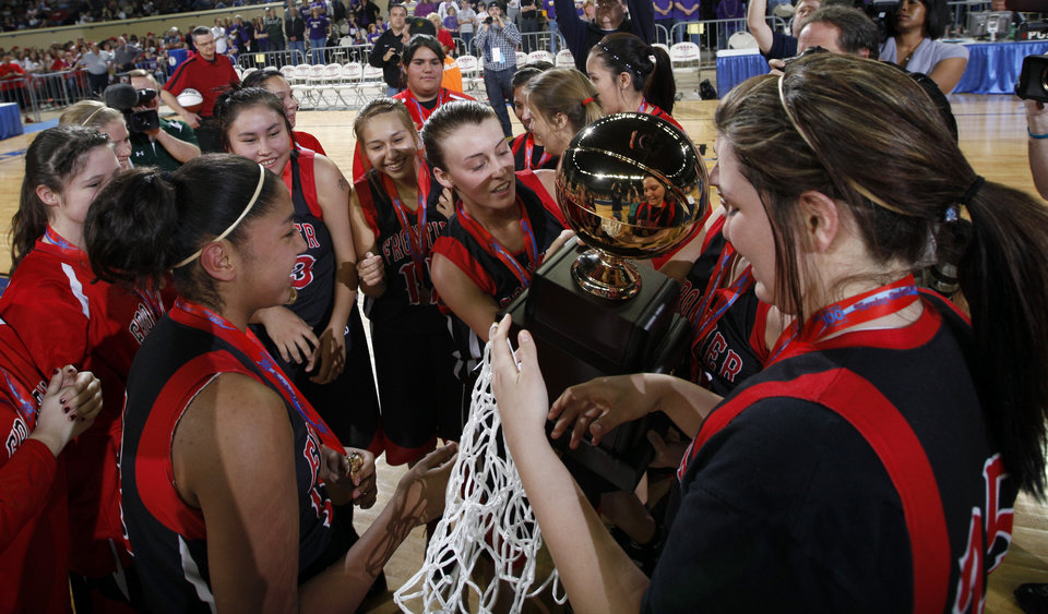 Frontier celebrates their state championship over Okarche in the girls Class A state basketball game between Okarche and Frontier  at the State Fair Arena in Oklahoma City,  Saturday, March 3, 2012. Photo by Sarah Phipps, The Oklahoman