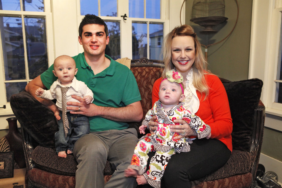 Brady Smith and wife Chelsea with their 5-month-old twins Elliot and Vivian at home in Oklahoma City.  <strong>David McDaniel - The Oklahoman</strong>