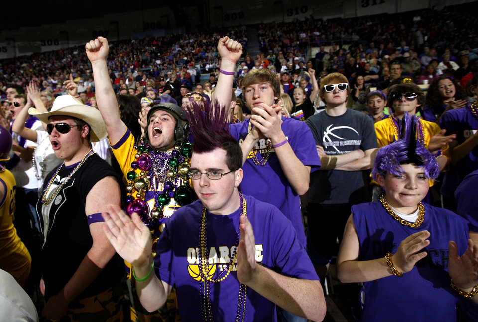 Photo - Okarche fans celebrate during the Class A girls state championship high school basketball game between  Okarche and Frontier  at the State Fair Arena in Oklahoma City,  Saturday, March 3, 2012. Photo by Sarah Phipps, The Oklahoman