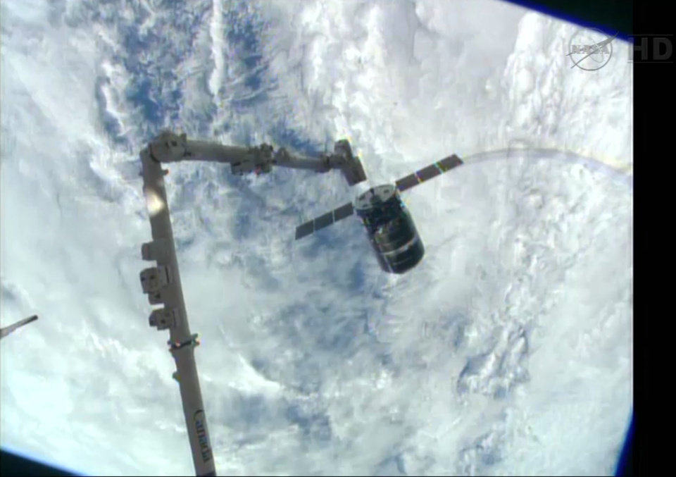 Photo - This framegrabbed image provided by NASA-TV shows the Cygnus spacecraft as it approaches the International Space Station Sunday Sept. 29, 2013. The Canadarm 2 which will grapple the spacecraft can be seen lower left. (AP Photo/NASA-TV)