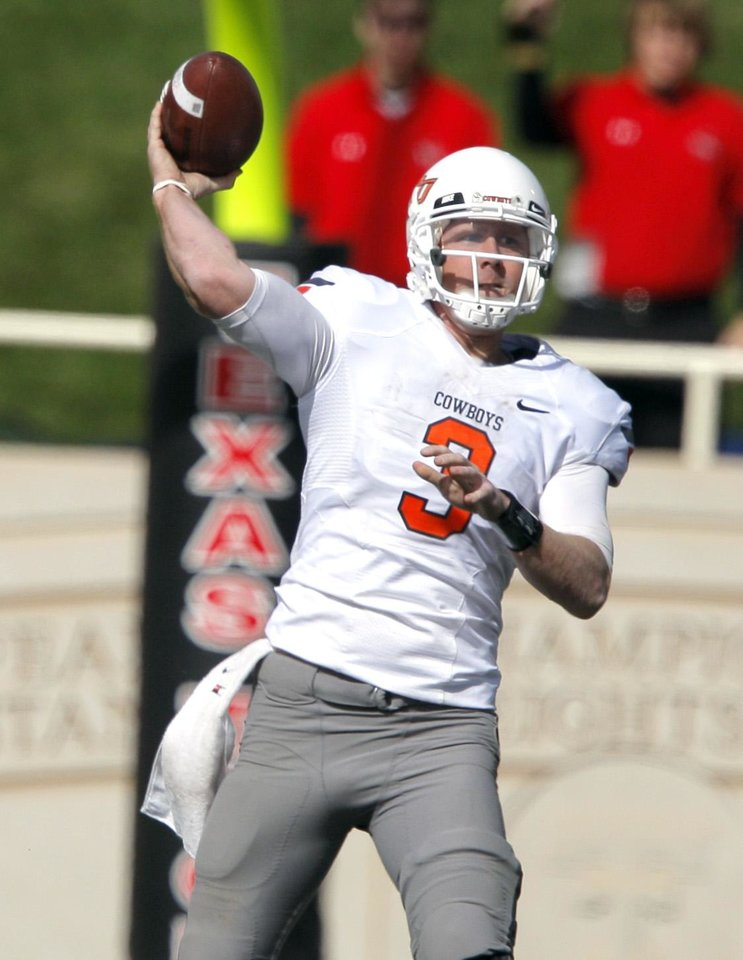 Oklahoma State's Brandon Weeden (3) throws the ball during a college football game between Texas Tech University (TTU) and Oklahoma State University (OSU) at Jones AT&T Stadium in Lubbock, Texas, Saturday, Nov. 12, 2011.  Photo by Sarah Phipps, The Oklahoman  ORG XMIT: KOD