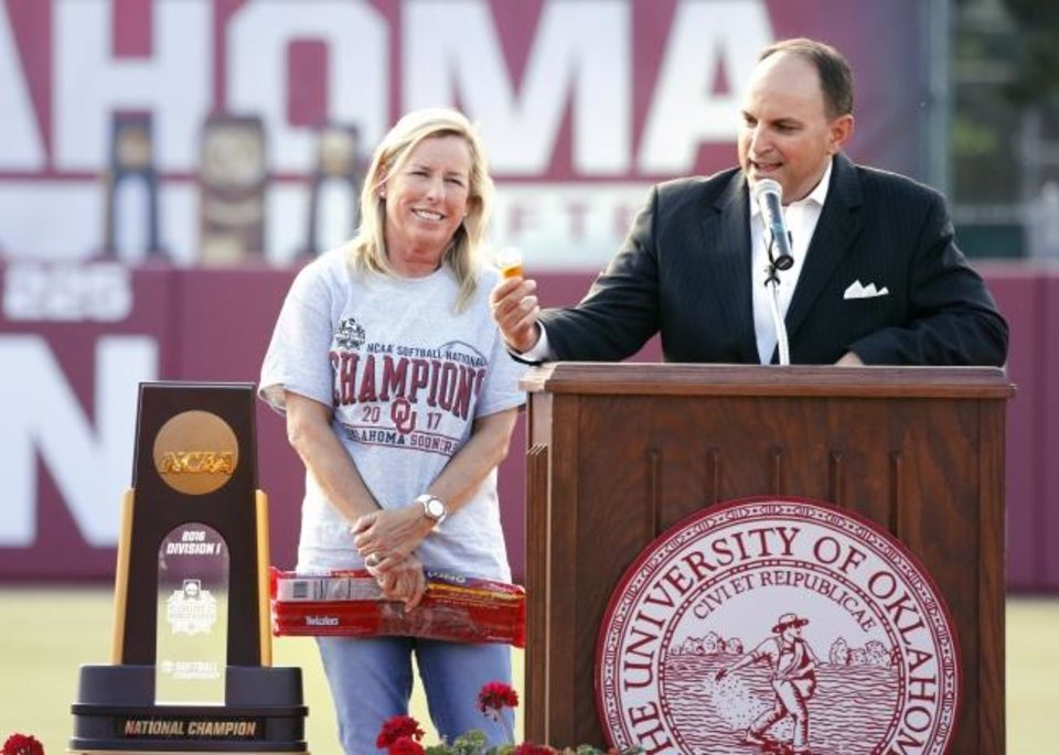 Photo -  Celebrating an NCAA softball title is nothing new for OU athletic director Joe Castiglione and coach Patty Gasso, who has won four of them.  [OKLAHOMAN ARCHIVES]