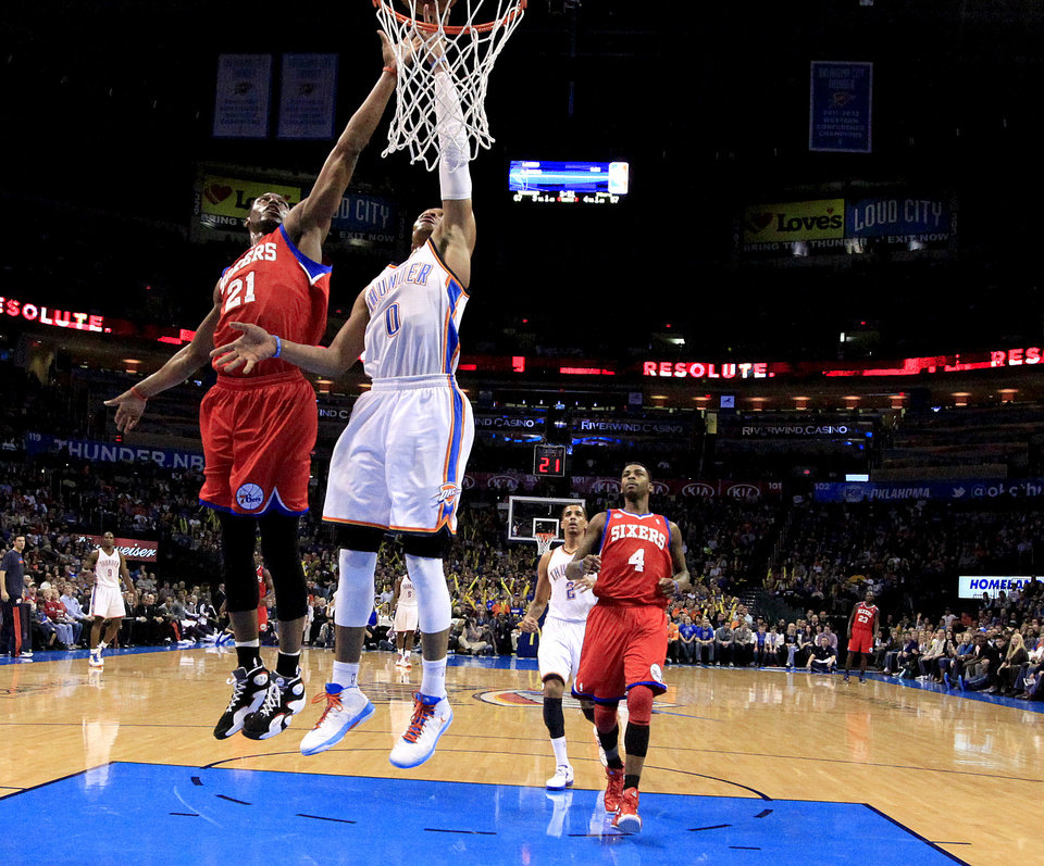 Oklahoma City's Russell Westbrook (0) dunks in front of Philadelphia's Thaddeus Young (21) and Dorell Wright (4) during the NBA game between the Oklahoma City Thunder and the Philadelphia 76ers at the Chesapeake Energy Arena in Oklahoma City, Saturday,Jan. 5, 2013. Photo by Sarah Phipps, The Oklahoman