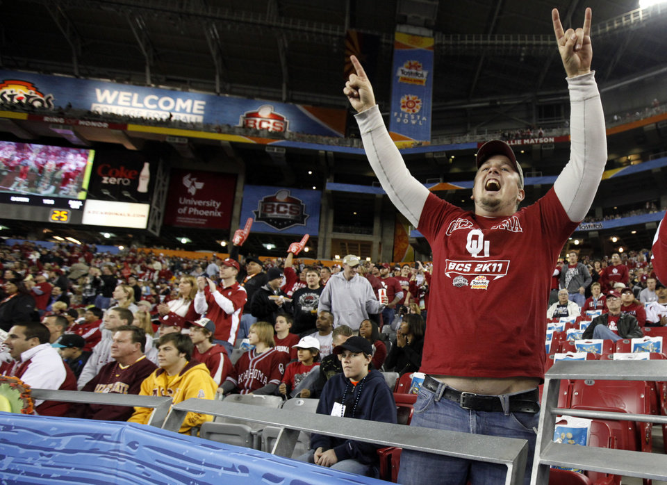 Russell Daniels, originally from Enid but now living in Phoenix, cheers during the Fiesta Bowl college football game between the University of Oklahoma Sooners and the University of Connecticut Huskies in Glendale, Ariz., at the University of Phoenix Stadium on Saturday, Jan. 1, 2011.  Photo by Bryan Terry, The Oklahoman
