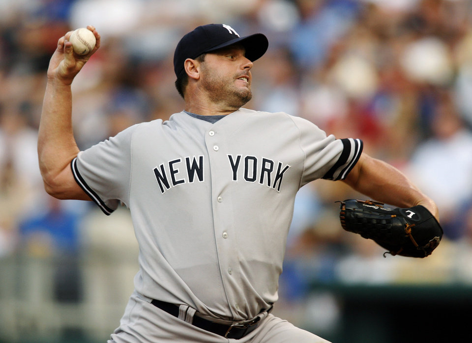 Photo - FILE - In this July 23, 2007, file photo, New York Yankees starting pitcher Roger Clemens throws against Kansas City Royals' David DeJesus in the first inning of a baseball game in Kansas City, Mo. Clemens, Barry Bonds and Sammy Sosa are set to show up on the Hall of Fame ballot for the first time on Wednesday, Nov. 28, 2012, and fans will soon find out whether drug allegations block the former stars from reaching baseball's shrine. (AP Photo/Ed Zurga, File)