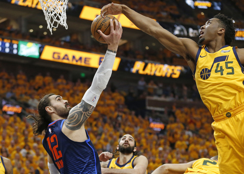 Photo - Utah Jazz guard Donovan Mitchell (45) defends against Oklahoma City Thunder center Steven Adams (12) during the first half of Game 6 of an NBA basketball first-round playoff series Friday, April 27, 2018, in Salt Lake City. (AP Photo/Rick Bowmer)