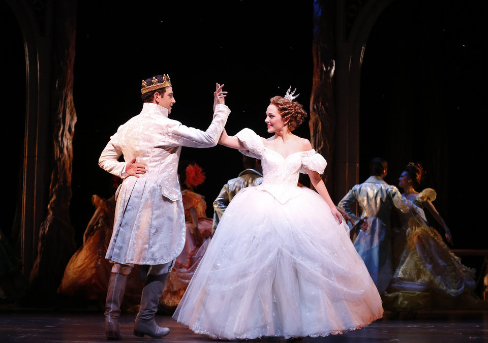 Photo - This theater image released by Sam Rudy Media Relations shows Laura Osnes as Cinderella, right, dancing with Santino Fontana as the Prince, during a performance of