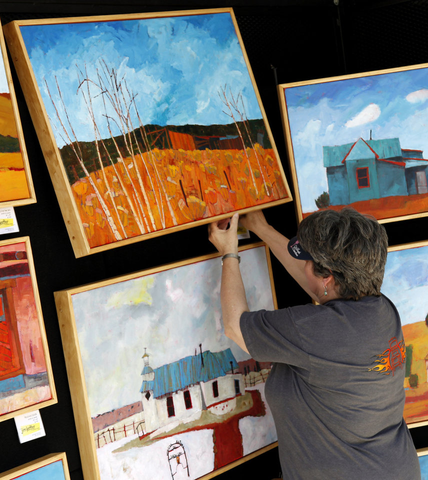Laurie Dale Keffer tags paintings done by her husband, Oklahoma City artist Jim Keffer Monday, April 21, 2012 in preparation for the Festival of the Arts starting Tuesday. Photo by Doug Hoke, The Oklahoman