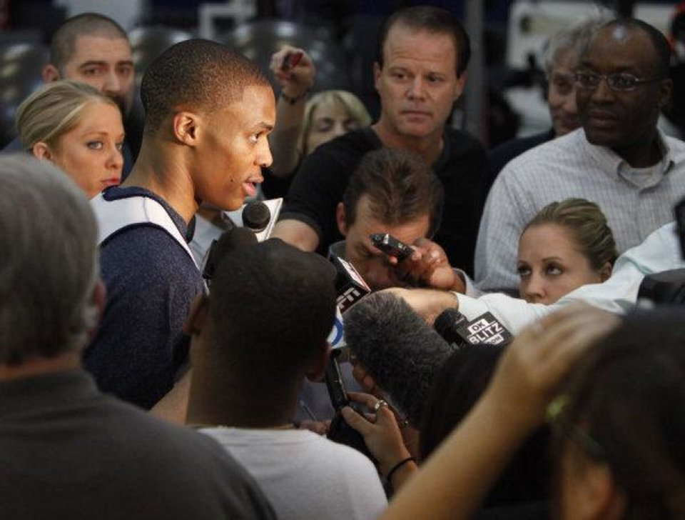 Photo - Russell Westbrook speaks to reporters during the Thunder's after practice media event at the Thunder practice facility in Oklahoma City, OK, Friday, May 20, 2011. By Paul Hellstern, The Oklahoman ORG XMIT: KOD  PAUL HELLSTERN