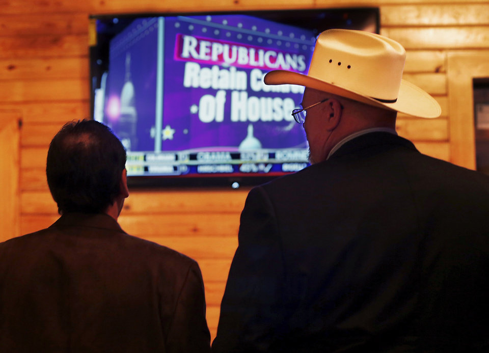 Two men watch election returns Tuesday night. About 200  friends and supporters  of Oklahoma County Sheriff John Whetsel gathered in Choctaw at Old Germany Restaurant to watch election results and cheer the numbers as they were shown on large television screens throughout the building Tuesday night, Nov. 6, 2012.   Photo by Jim Beckel, The Oklahoman