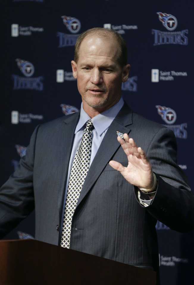 Photo - Tennessee Titans coach Ken Whisenhunt answers questions at a news conference Tuesday, Jan. 14, 2014, in Nashville, Tenn. Whisenhunt says one thing he's learned about the NFL is the importance of chemistry, and he decided the Titans were the best fit for his second chance to run a team. (AP Photo/Mark Humphrey)