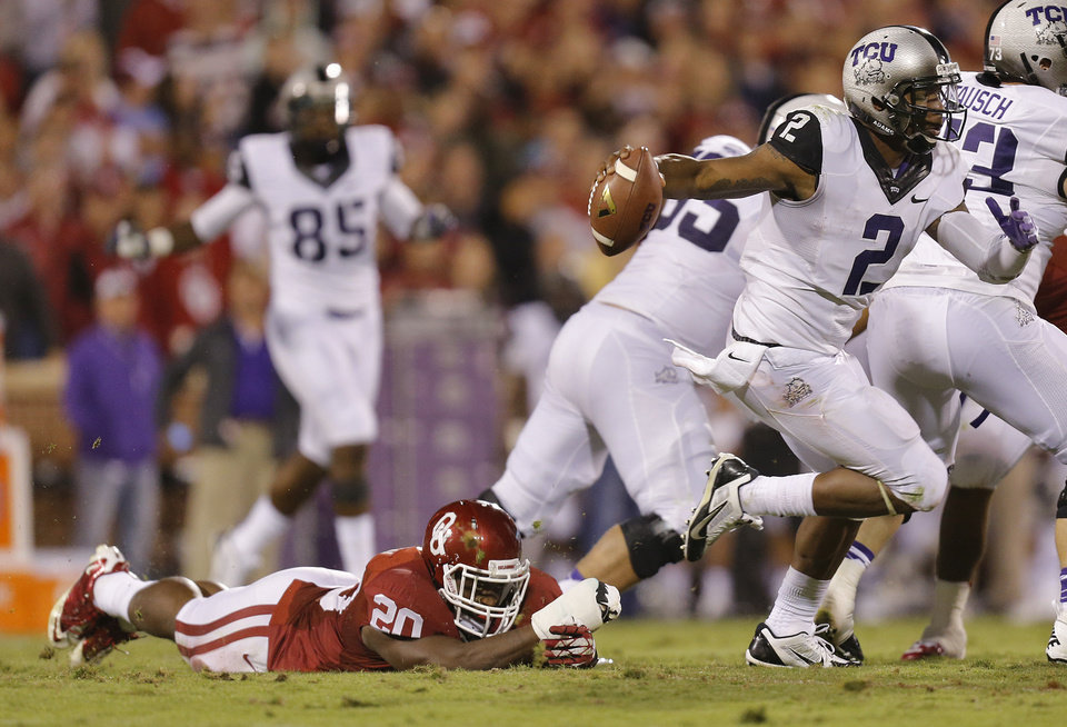 Photo - TCU 's Trevone Boykin (2) escapes Oklahoma's Frank Shannon (20) during the college football game between the University of Oklahoma Sooners (OU) and the Texas Christian University Horned Frogs (TCU) at the Gaylord Family-Oklahoma Memorial Stadium on Saturday, Oct. 5, 2013 in Norman, Okla.   Photo by Chris Landsberger, The Oklahoman