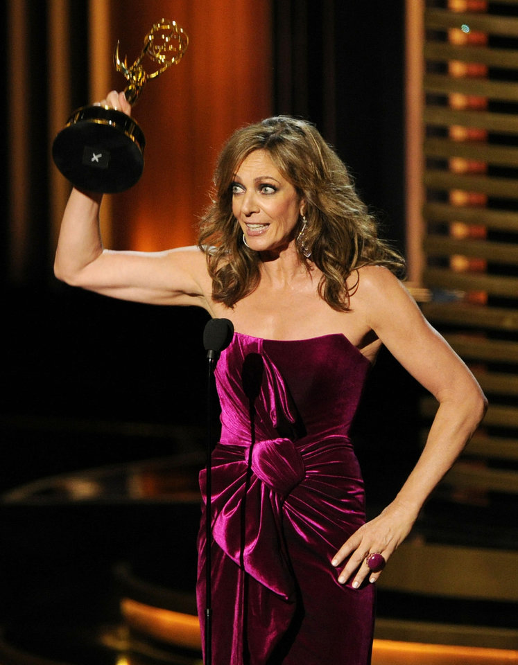 "Photo - Allison Janney accepts the award for outstanding supporting actress in a comedy series for her role in ""Mom"" at the 66th Annual Primetime Emmy Awards at the Nokia Theatre L.A. Live on Monday, Aug. 25, 2014, in Los Angeles. (Photo by Chris Pizzello/Invision/AP)"