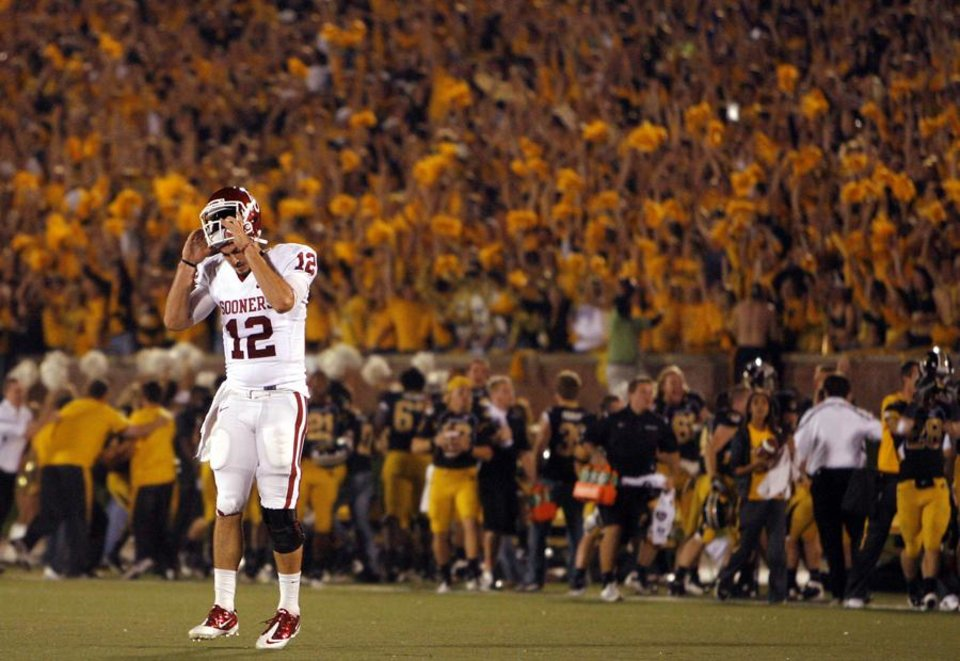 Photo -  Oklahoma's Landry Jones (12) reacts as he walks off the field after a Mossis Madu fumble in the red zone during the first half of the college football game between the University of Oklahoma Sooners (OU) and the University of Missouri Tigers (MU) on Saturday, Oct. 23, 2010, in Columbia, Mo.  Photo by Chris Landsberger, The Oklahoman ORG XMIT: KOD