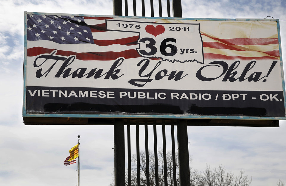 Photo - A large billboard rises above the building on Classen Boulevard where Mai Ly Do has operated a Vietnamese radio station for 12 years. The sign is thanking Okla homa for welcoming Vietnamese residents who were fleeing their country in 1975.  Jim Beckel -  THE OKLAHOMAN