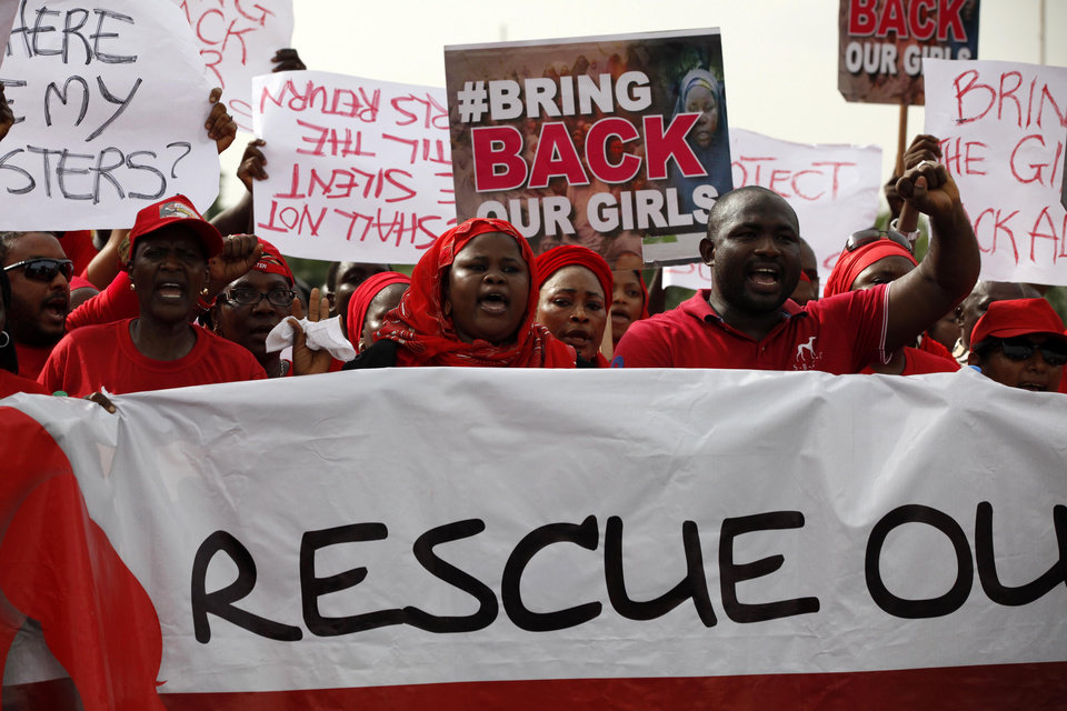 Photo - FILE-  In this Thursday May 22, 2014 file photo. People attend a demonstration calling on the government to rescue the kidnapped girls of the government secondary school in Chibok, Nigeria, in Abuja. At least 11 parents of the more than 200 kidnapped Nigerian schoolgirls will never see their daughters again. Since the mass abduction of the schoolgirls by Islamic extremists three months ago, at least 11 of their parents have died and their hometown, Chibok, is under siege from the militants, residents report. Seven fathers of kidnapped girls were among 51 bodies brought to Chibok hospital after an attack on the nearby village of Kautakari this month, said a health worker who insisted on anonymity for fear of reprisals by the extremists. At least four more parents have died of heart failure, high blood pressure and other illnesses that the community blames on trauma due to the mass abduction 100 days ago, said community leader Pogu Bitrus, who provided their names.  (AP Photo/Sunday Alamba File)