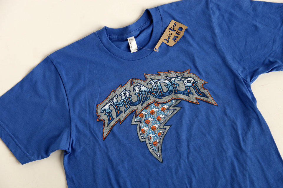 Photo - Thunder T-shirt sold at DNA Galleries. Photo by Doug Hoke, The Oklahoman  DOUG HOKE