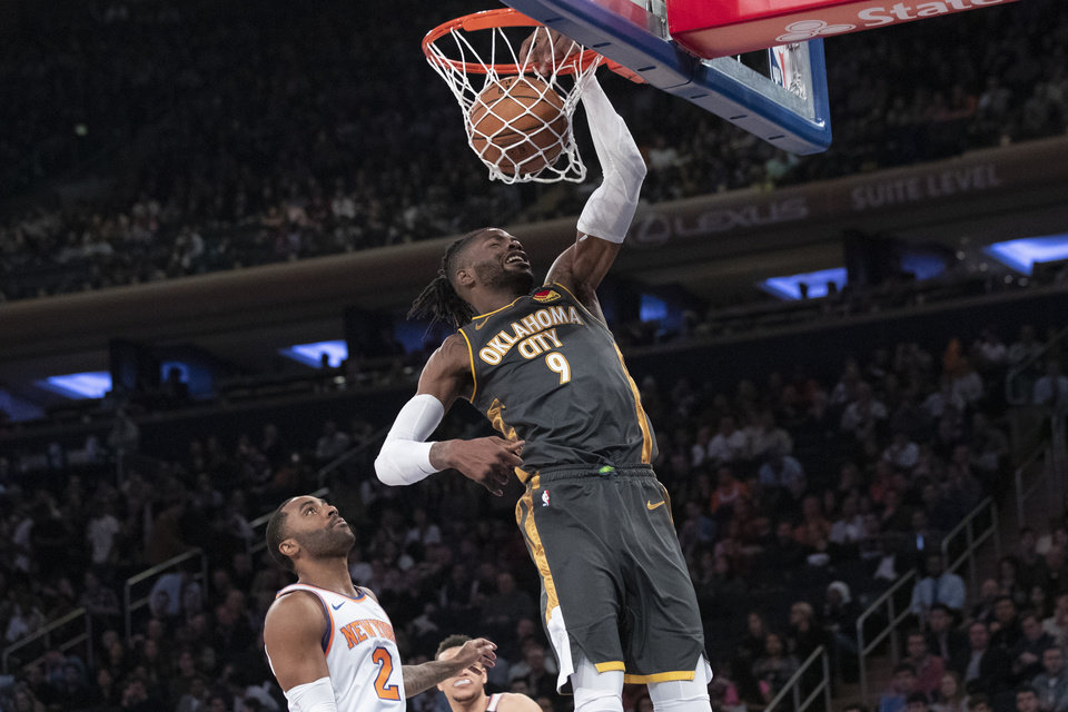 Photo - Oklahoma City Thunder center Nerlens Noel (9) dunks past New York Knicks guard Wayne Ellington (2) in the first half of an NBA basketball game, Friday, March 6, 2020, at Madison Square Garden in New York. (AP Photo/Mary Altaffer)