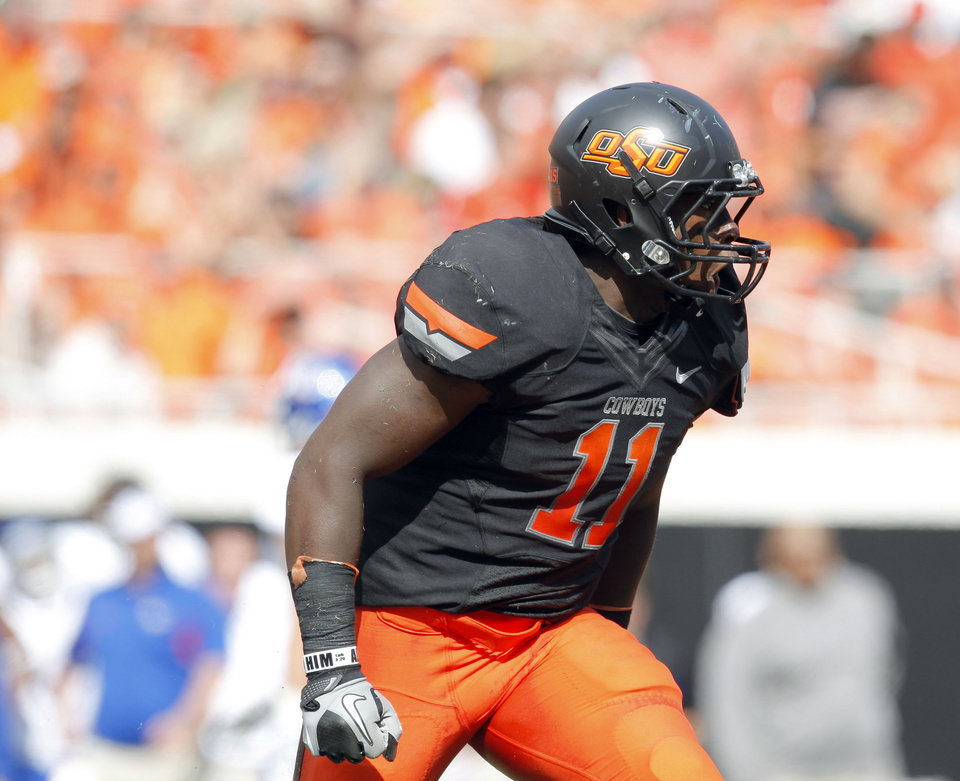 CELEBRATION: Oklahoma State\'s Shaun Lewis (11) celebrates a sack during the first half of the college football game between the Oklahoma State University Cowboys (OSU) and the University of Kansas Jayhawks (KU) at Boone Pickens Stadium in Stillwater, Okla., Saturday, Oct. 8, 2011. Photo by Sarah Phipps, The Oklahoman ORG XMIT: KOD