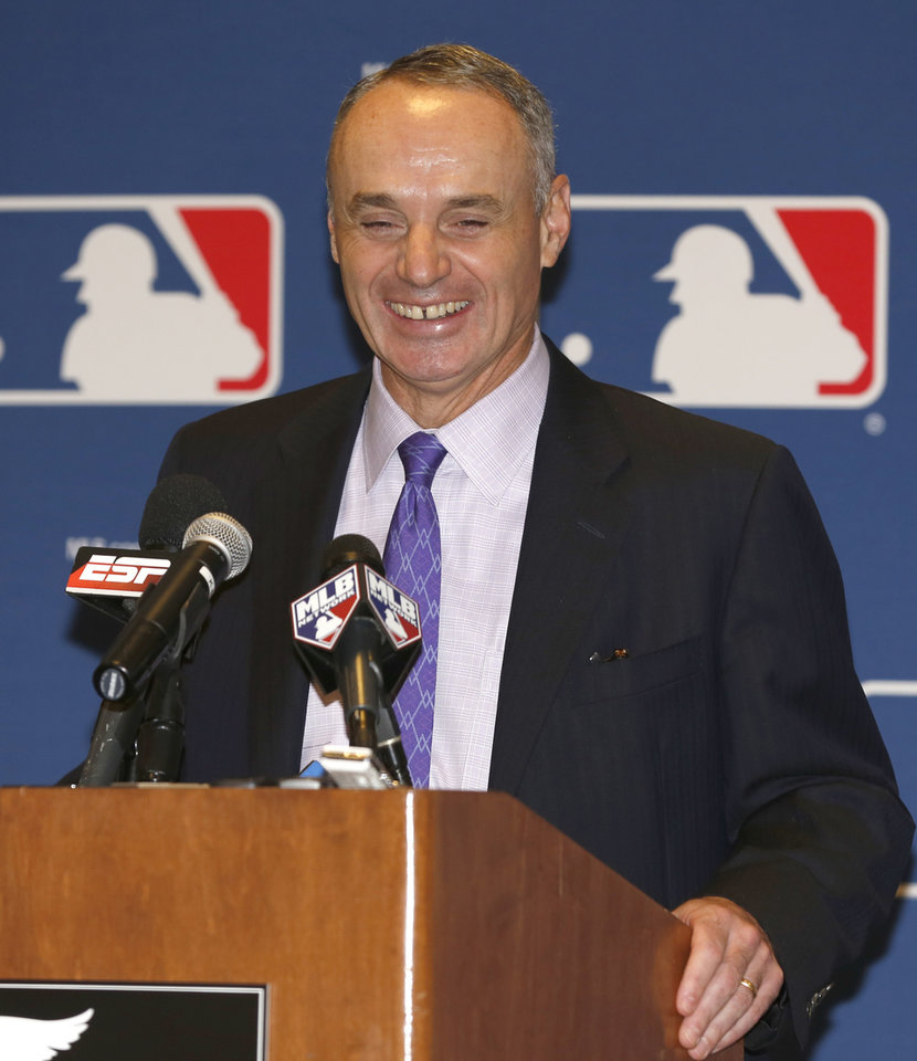 Photo - FILE - In this Nov. 14, 2013, file photo, Major League Baseball Chief Operating Officer Rob Manfred talks to the media following baseball's general managers' meetings in Orlando, Fla. Baseball's 30 owners will meet in Baltimore this week to vote on Major League Baseball Commissioner Bud Selig's replacement. A seven-man committee whittled down an expansive list to three candidates: MLB Chief Operating Officer Rob Manfred, Boston Red Sox Chairman Tom Werner and MLB Executive Vice President of Business Tim Brosnan. (AP Photo/Reinhold Matay, File)