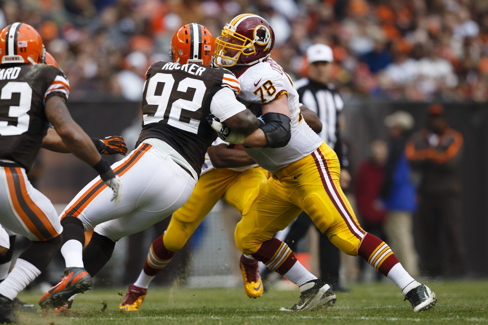 ADVANCE FOR WEEKEND EDITIONS, MARCH 9-10 - FILE - In this Dec. 16, 2012, file photo, Washington Redskins guard Kory Lichtensteiger (78) blocks Cleveland Browns defensive end Frostee Rucker (92) during an NFL football game in Cleveland. Lichtensteiger and Lorenzo Alexander are scheduled to become free agents on Tuesday. Coach Mike Shanahan likes them both. A lot. The feeling is mutual _ they want to keep playing for the Redskins. (AP Photo/Rick Osentoski, File)