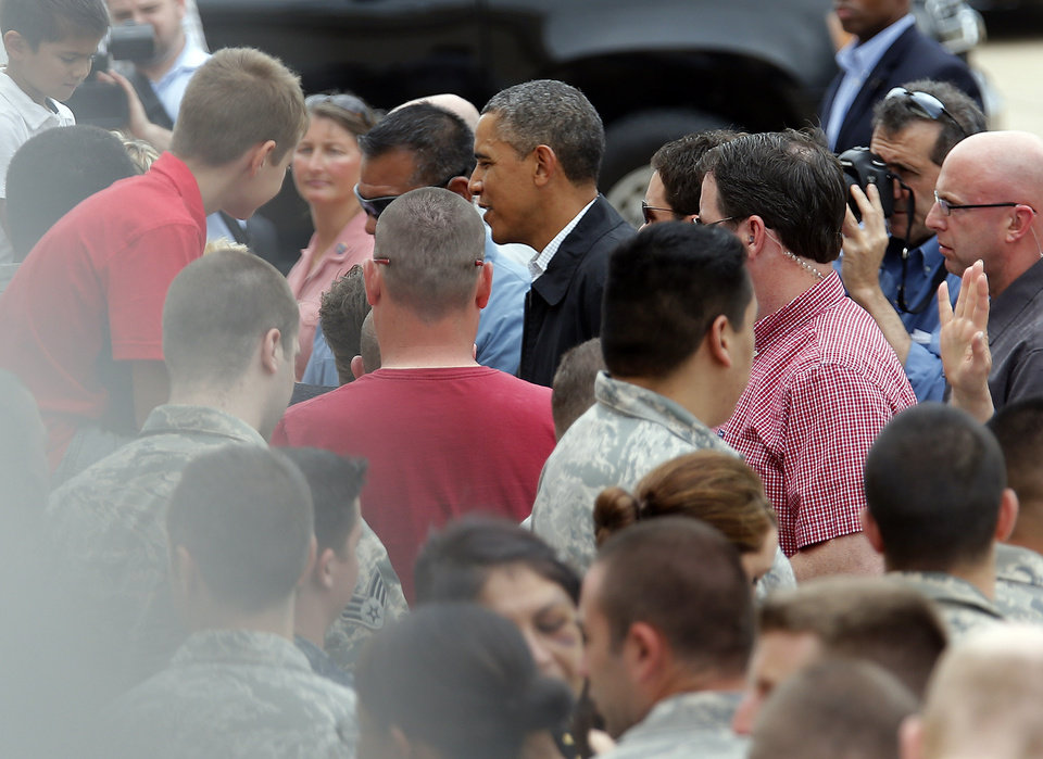 President Barack Obama greets guest at Tinker Air Force base in Midwest City, Sunday, May 26, 2013. Obama was in town to visit areas damaged by the May 20 tornado. Photo by Sarah Phipps, The Oklahoman
