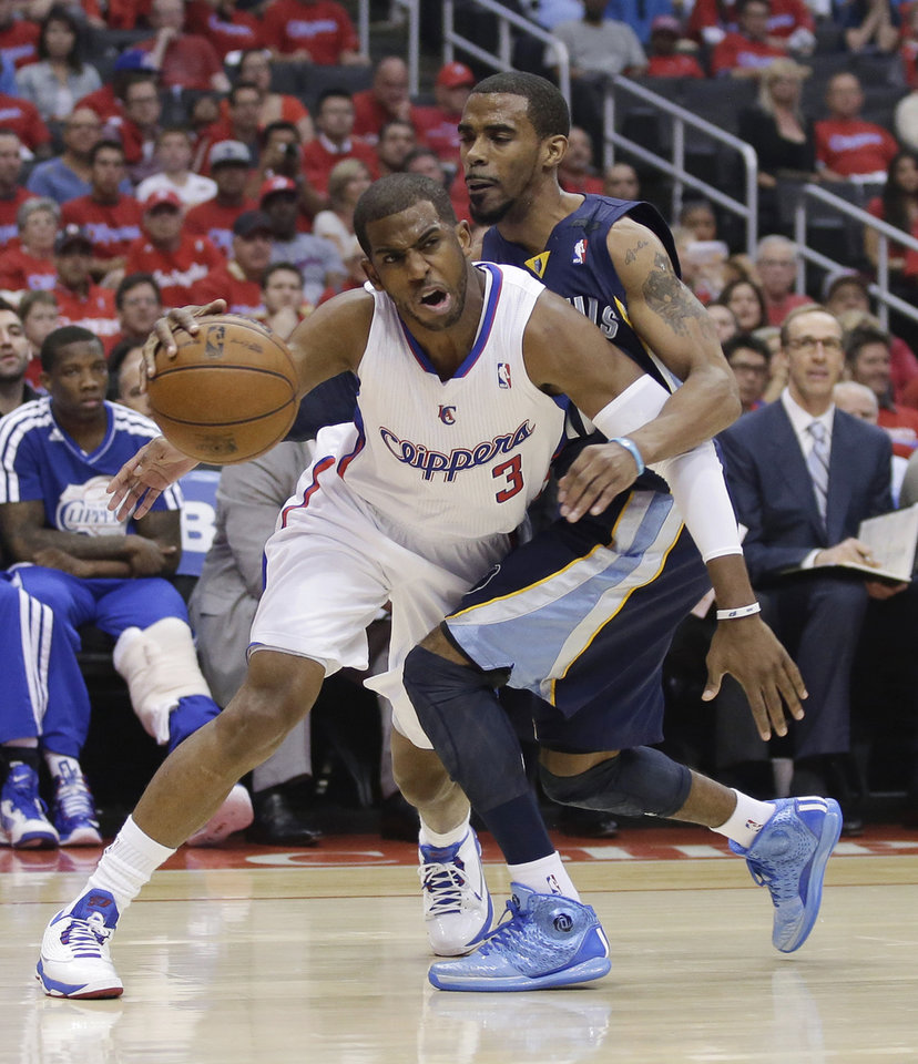 Los Angeles Clippers guard Chris Paul, left, tries to get past Memphis Grizzlies guard Mike Conley during the first half of Game 1 of a first-round NBA basketball playoff series in Los Angeles, Saturday, April 20, 2013. (AP Photo/Chris Carlson)