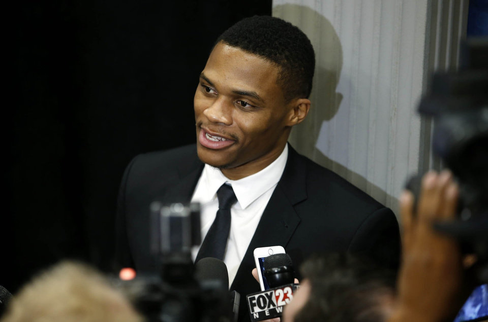 Photo - 8th annual Oklahoma Hall of Fame presenter Russell Westbrook talks to the media prior to the induction ceremony at the Renaissance Hotel in Tulsa, Okla., taken on November 19, 2015. JAMES GIBBARD/Tulsa World