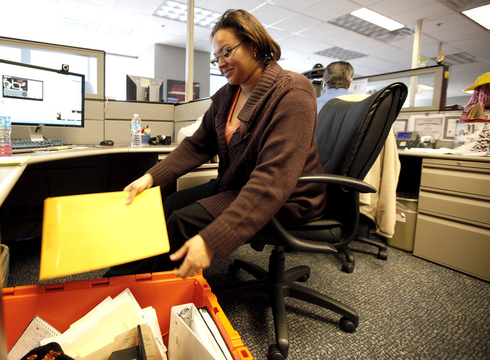 Devon service representative Shana Harper packs her desk at the Chase Tower in Oklahoma City, Thursday, March 15, 2012. Photo by Sarah Phipps, The Oklahoman.