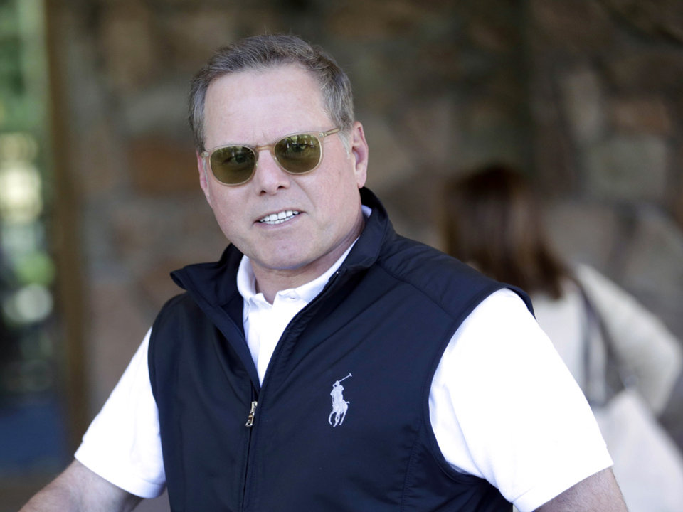 Photo - FILE - In this July 9, 2013 file photo, David Zaslav, president and chief executive officer of Discovery Communications Inc., arrives at the Allen & Company Sun Valley Conference in Sun Valley, Idaho. Zaslav was the eighth highest paid CEO in 2013 at $33.3 million, as calculated by The Associated Press and Equilar, an executive pay research firm. (AP Photo/Rick Bowmer, File)