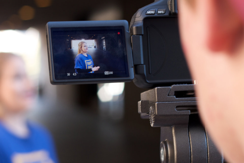 Photo -  A young mentee films an interview of Kari Sowers of The Mentoring Project as part of a collaboration with OKC GOOD. Photo by James A. Pearson., for The Oklahoman