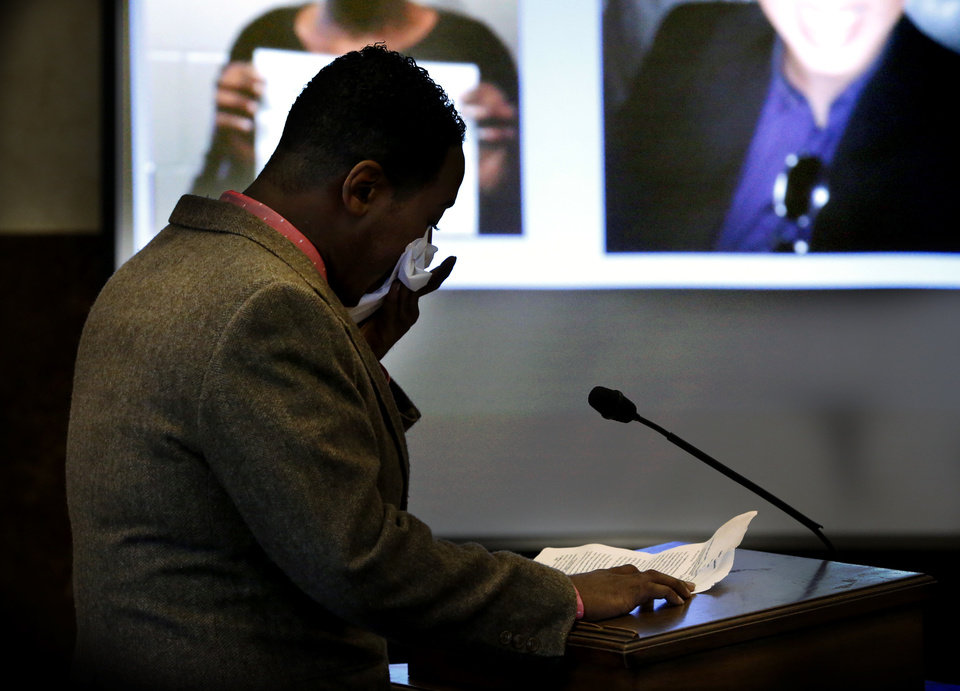 Photo -  Graduate Deyon Shelly becomes emotional Thursday as he reads his statement during Drug Court Graduation in Norman. [Photo by Steve Sisney, The Oklahoman]