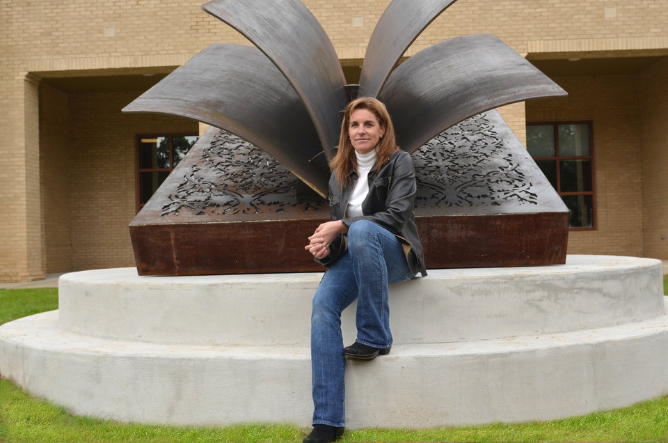 Photo - Deedee Morrison poses with one of her sculptures.   Photo provided  Photo provided