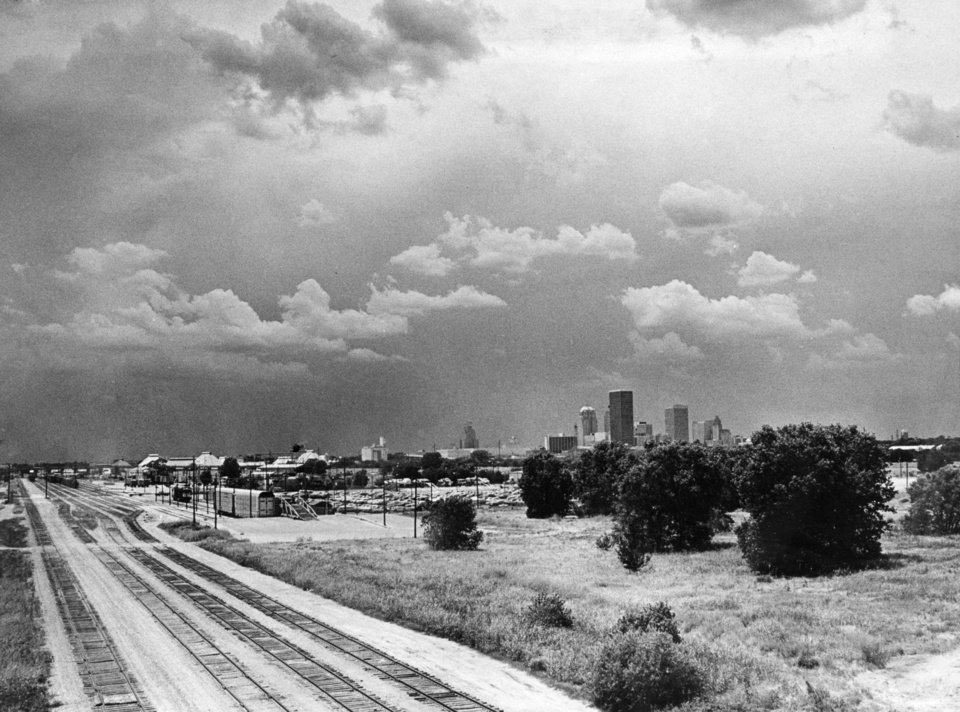 OKLAHOMA CITY / SKY LINE / OKLAHOMA: CLOUDS rolling in from the west form a backdrop for Oklahoma City\'s skyline, but they brought no noticeable change in temperature or rainfall. Skies Monday should remain fair to partly cloudy, with a high temperature near 90. Staff photo by Monty Reed. Photo dated 06/12/1977 and published 06/13/1977 in The Daily Oklahoman.