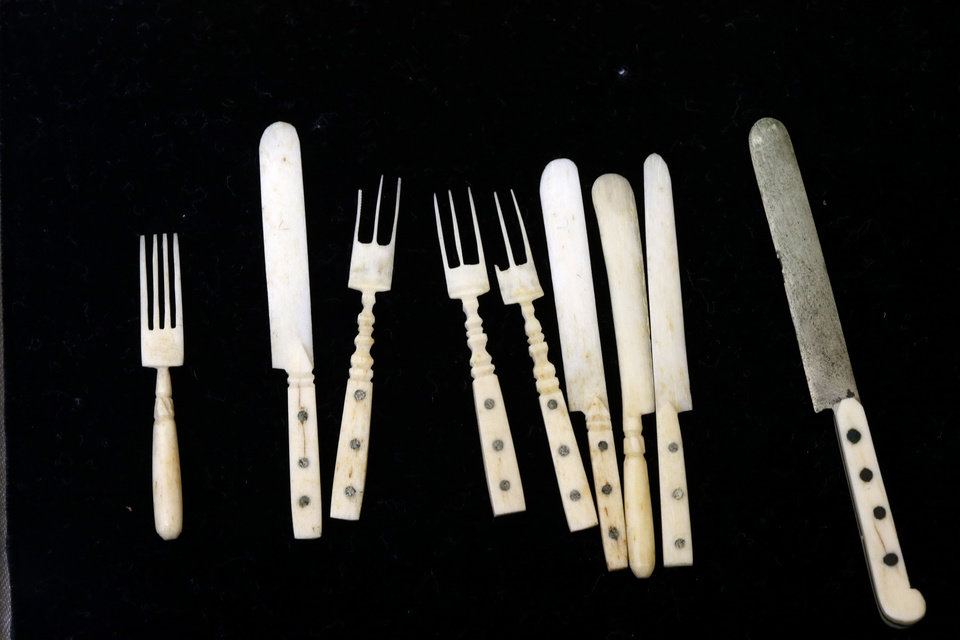 Photo - In this Tuesday, March 12, 2013 photo, shown is a miniature cutlery set made from bones in an unknown inmate's soup at the Eastern State Penitentiary in Philadelphia. The defunct and decayed prison that serves as one of Philadelphia's quirkiest tourist attractions, plans to displaying dozens of never-before-seen artifacts for 10 days only in a