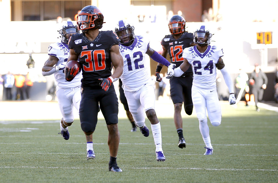 Photo - Oklahoma State's Chuba Hubbard (30) rushes for a 92-yard touchdown in the third quarter during the college football game between the Oklahoma State University Cowboys and the TCU Horned Frogs at Boone Pickens Stadium in Stillwater, Okla.,  Saturday, Nov. 2, 2019. OSU won 34-27. [Sarah Phipps/The Oklahoman]