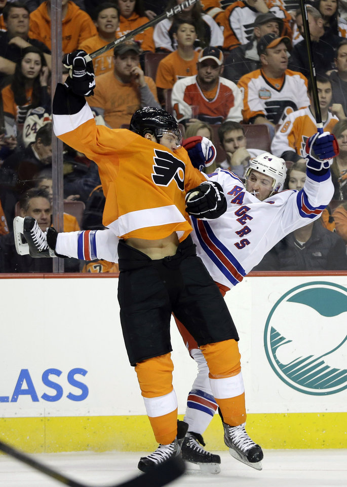Philadelphia Flyers' Tye McGinn, left, and New York Rangers' Ryan Callahan collide during the first period of an NHL hockey game, Thursday, Jan. 24, 2013, in Philadelphia. (AP Photo/Matt Slocum)